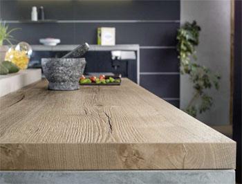 urbana elegante abierta la cocina se ha impuesto estos ltimos aos como lugar de convivencia privilegiado la encimera convertida en un elemento que - Encimeras De Cocina Aglomerado